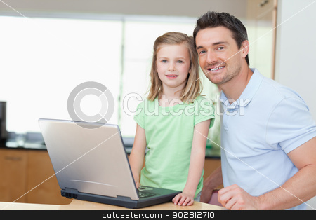 Father and daughter using laptop stock photo, Father and daughter using laptop together by Wavebreak Media