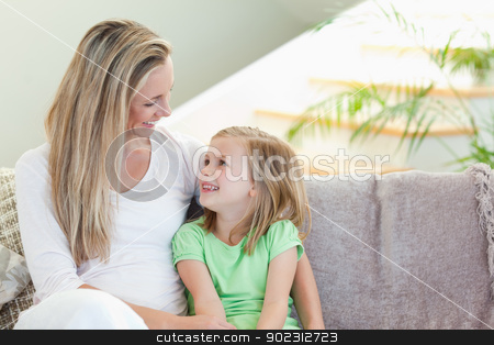 Mother and daughter sitting on sofa stock photo, Mother and daughter sitting on the sofa by Wavebreak Media
