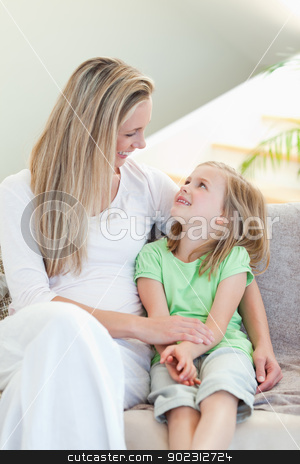 Mother and daughter sitting on couch stock photo, Mother and daughter sitting on the couch by Wavebreak Media