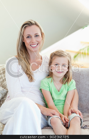 Mother and daughter sitting on sofa together stock photo, Mother and daughter sitting on the sofa together by Wavebreak Media