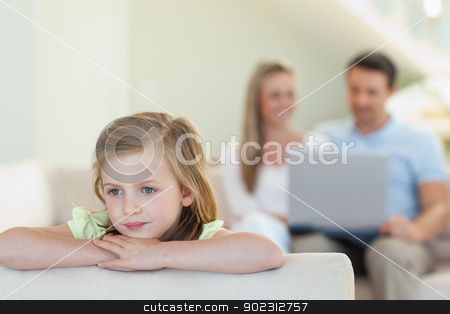 Thoughtful girl with parents behind her stock photo, Thoughtful girl with her parents behind her by Wavebreak Media