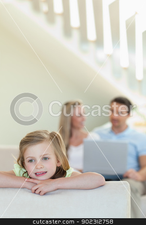 Girl in thoughts with parents behind her stock photo, Girl in thoughts with her parents behind her by Wavebreak Media