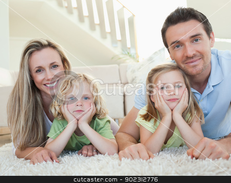 Family lying on the floor stock photo, Family lying on the floor together by Wavebreak Media