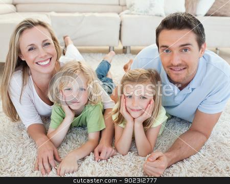 Family lying on the carpet stock photo, Family lying on the carpet together by Wavebreak Media