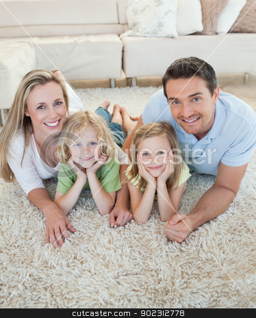 Happy family on the floor stock photo, Happy family together on the floor by Wavebreak Media