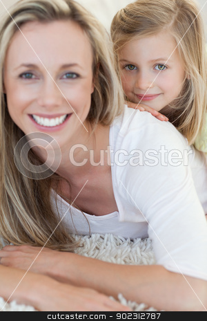 Happy mother and daughter on the floor stock photo, Happy mother and daughter together on the floor by Wavebreak Media