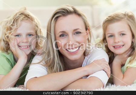 Mother with her children on the floor stock photo, Mother together with her children on the floor by Wavebreak Media