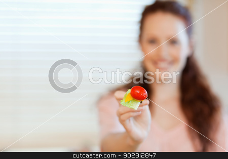 Mouthful of salad being offered by girl stock photo, Mouthful of healthy salad being offered by girl by Wavebreak Media