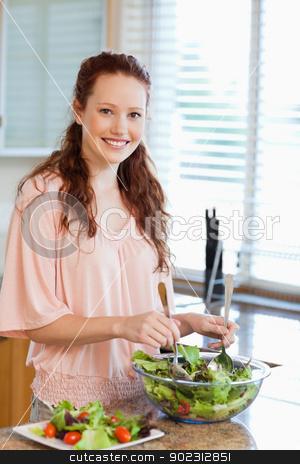 Woman preparing salad stock photo, Woman preparing green salad by Wavebreak Media