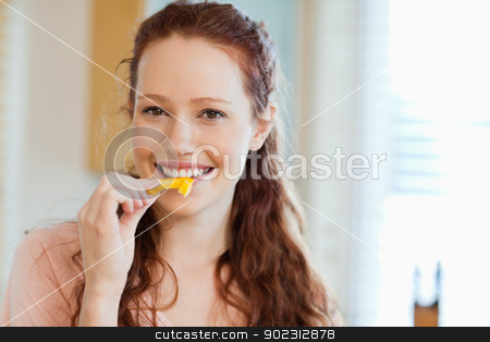 Woman about to bite into bell pepper stock photo, Woman about to bite into yellow bell pepper by Wavebreak Media