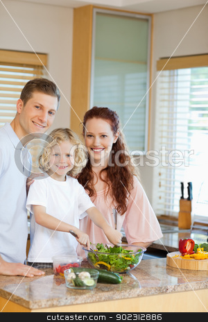 Young family preparing salad stock photo, Young family preparing salad together by Wavebreak Media