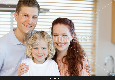 Cheerful family standing in the kitchen stock photo, Cheerful family standing in the kitchen together by Wavebreak Media