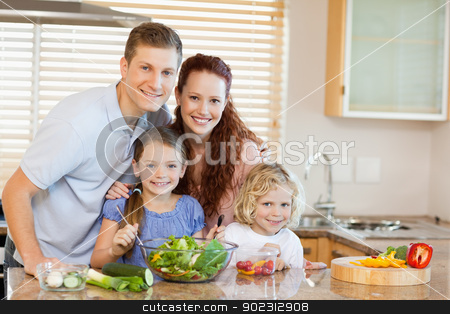 Family in the kitchen stock photo, Family together in the kitchen by Wavebreak Media
