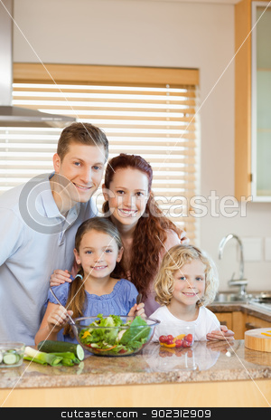 Family standing in the kitchen stock photo, Family standing together in the kitchen by Wavebreak Media