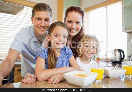 Family with breakfast in the kitchen stock photo, Family together with breakfast in the kitchen by Wavebreak Media