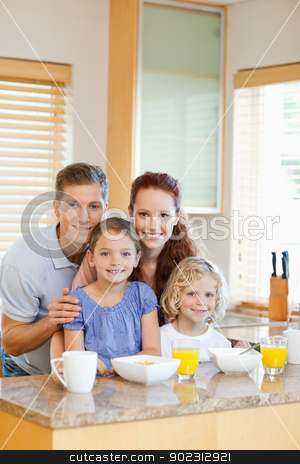 Family with their breakfast in the kitchen stock photo, Smiling family with their breakfast in the kitchen by Wavebreak Media