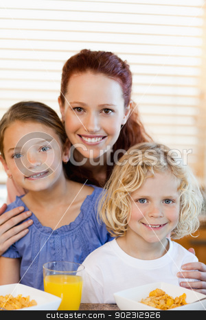 Mother with children and cereals in the kitchen stock photo, Mother with children and cereals together in the kitchen by Wavebreak Media