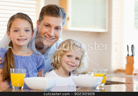 Father with his children in the kitchen stock photo, Father together with his children in the kitchen by Wavebreak Media