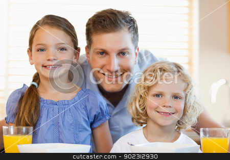 Smiling father with his children in the kitchen stock photo, Smiling father together with his children in the kitchen by Wavebreak Media