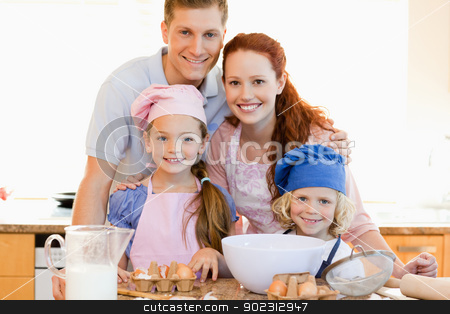 Family with baking ingredients in the kitchen stock photo, Family together with baking ingredients in the kitchen by Wavebreak Media