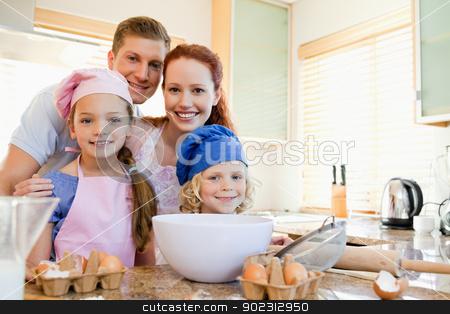 Cheerful family preparing dough stock photo, Cheerful happy family preparing dough by Wavebreak Media