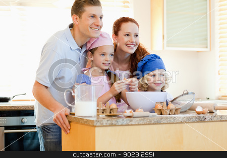 Family in the kitchen with baking ingredients stock photo, Happy family in the kitchen with baking ingredients by Wavebreak Media