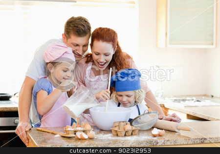 Family having a great time baking together stock photo, Happy family having a great time baking together by Wavebreak Media