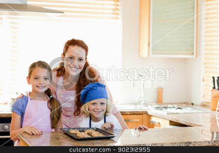 Mother with children and cookies in the kitchen stock photo, Mother together with children and cookies in the kitchen by Wavebreak Media