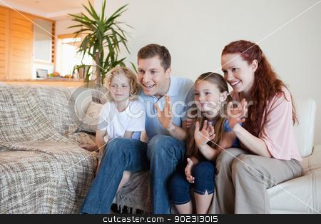 Family waving their hands stock photo, Family waving their hands in the living room by Wavebreak Media