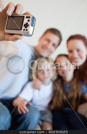 Digi cam being used to take family picture stock photo, Digi cam being used by father to take family picture by Wavebreak Media