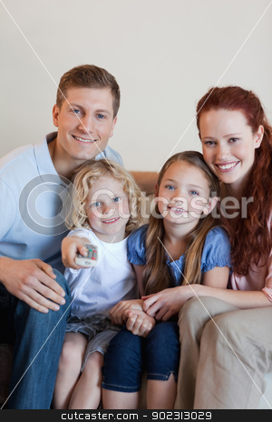 Happy family watching television together stock photo, Happy smiling family watching television together by Wavebreak Media