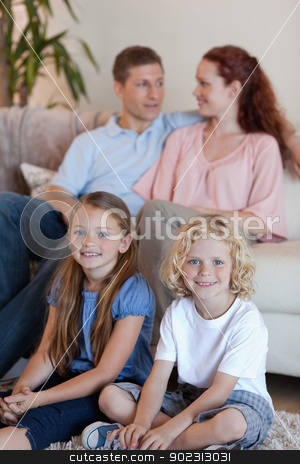 Family spending time in front of the tv stock photo, Young family spending time in front of the tv by Wavebreak Media