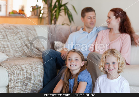 Family enjoying their time together stock photo, Family enjoying their time together in the living room by Wavebreak Media