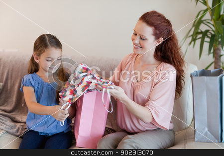 Mother and daughter looking at shopping stock photo, Mother and daughter looking at their shopping by Wavebreak Media