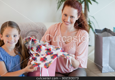 Mother and daughter on the sofa with shopping stock photo, Mother and daughter on the sofa with their shopping by Wavebreak Media