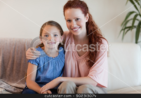 Happy mother and daughter on the sofa stock photo, Happy smiling mother and daughter on the sofa by Wavebreak Media