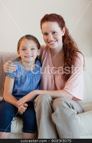 Mother and daughter on the couch stock photo, Happy mother and daughter on the couch by Wavebreak Media