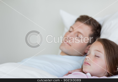 Side view of father and daughter asleep stock photo, Side view of father and daughter asleep together by Wavebreak Media