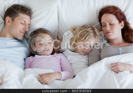 Family taking a rest together stock photo, Young family taking a rest together by Wavebreak Media
