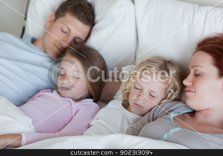 Family snoozing together stock photo, Young family snoozing together by Wavebreak Media
