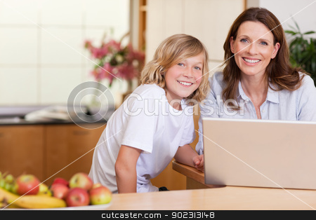 Woman with son on the laptop stock photo, Woman with her son on the laptop by Wavebreak Media