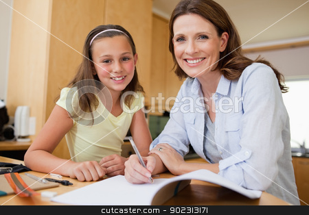 Mother and daughter doing homework stock photo, Mother and daughter doing homework together by Wavebreak Media
