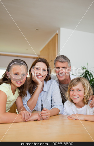 Family sitting at table stock photo, Family sitting together at table by Wavebreak Media