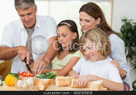 Family making sandwiches stock photo, Family making sandwiches together by Wavebreak Media