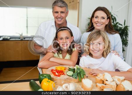 Cheerful family making sandwiches stock photo, Cheerful family making sandwiches together by Wavebreak Media