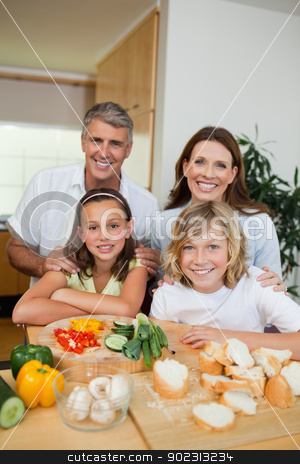 Happy family making sandwiches stock photo, Happy family making sandwiches together by Wavebreak Media