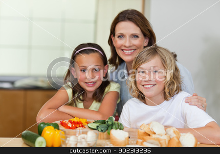 Siblings and mother making sandwiches stock photo, Siblings and mother making sandwiches together by Wavebreak Media