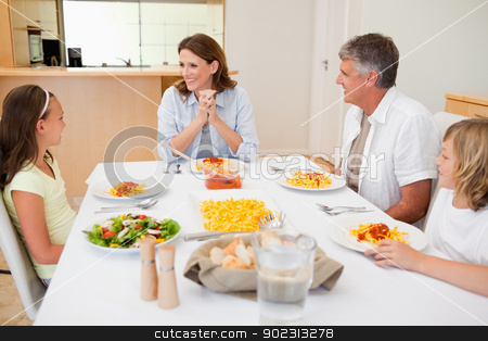 Family sitting at the dinner table stock photo, Family sitting at the dinner table together by Wavebreak Media