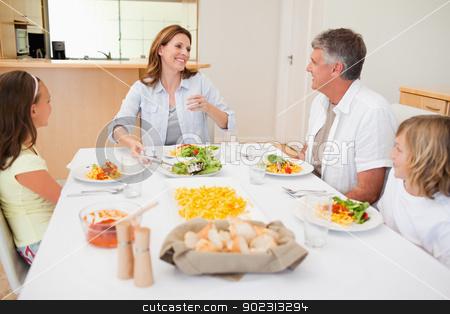 Cheerful family at the dinner table stock photo, Cheerful family together at the dinner table by Wavebreak Media