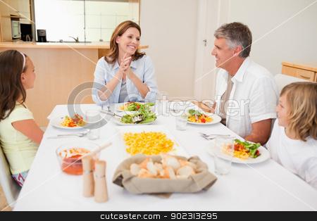 Happy family at the dinner table stock photo, Happy family together at the dinner table by Wavebreak Media